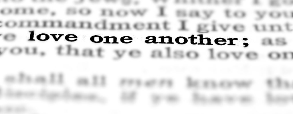 Detail closeup of New Testament Scripture quote Love One Another
